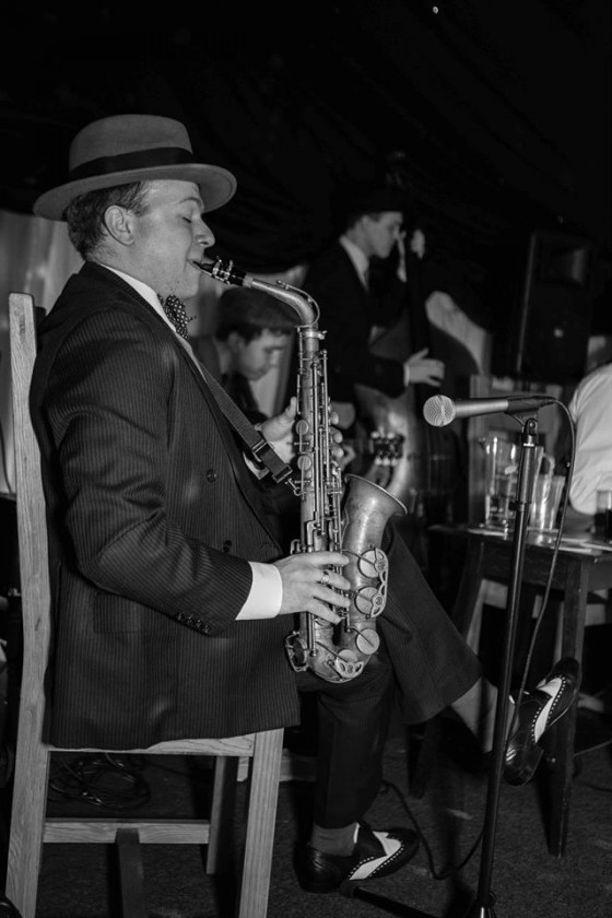 Jazz Spiv saxophonist performs at 1920s themed birthday party